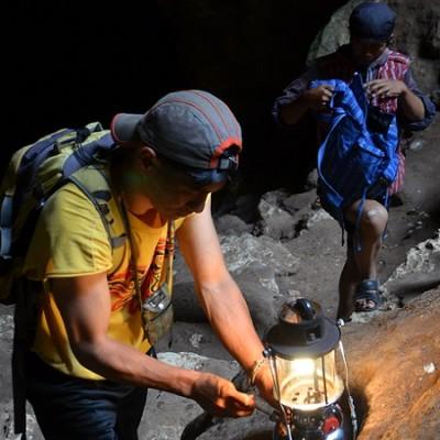 Sagada tour guides preparing their equipments to go into the cave