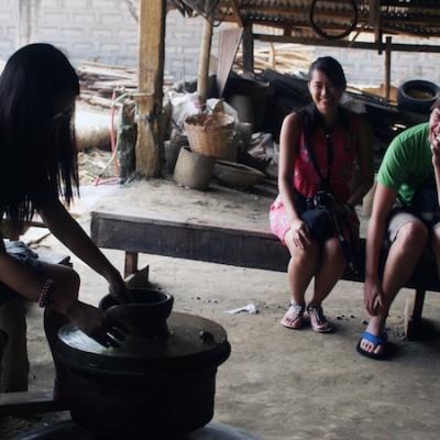 tourists enjoying our Vigan tour_ pottery making