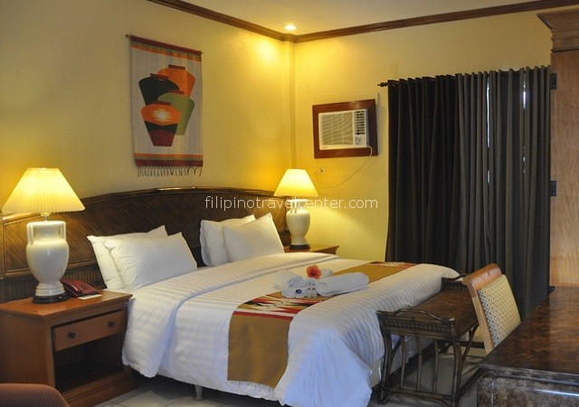 Garden aircon room with hot water, minibar and TV