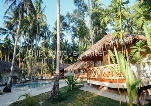 Mahogany Resorts Facade with swimming pool