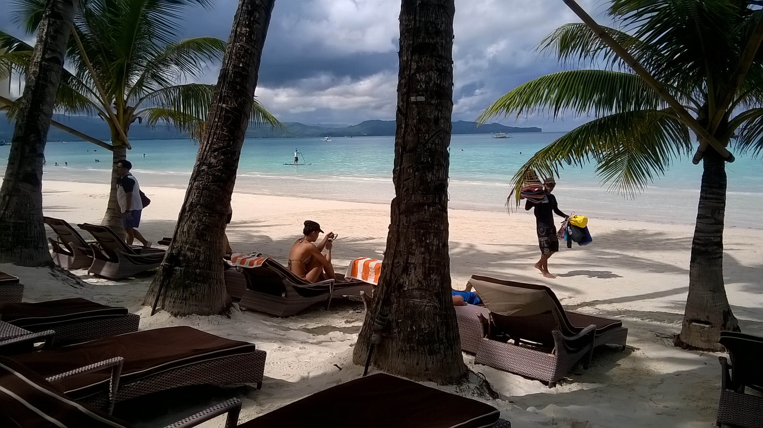 guests enjoying White Beach Boracay infront of Ambassador Hotel