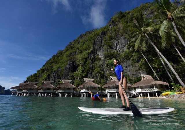 Miniloc Island stand up paddle boarding